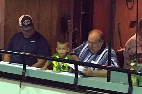 Owner Jeff Craig teaching his grandson.